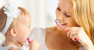 mother and child brushing teeth